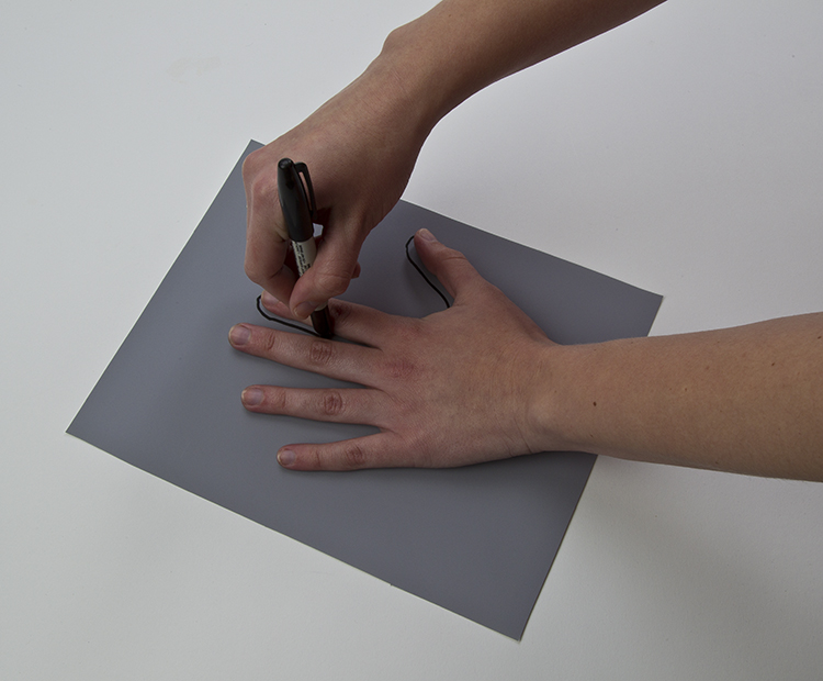 Hand on paper