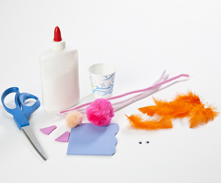 Materials: red or orange feathers, chenille stems, pom-poms, googly eyes, scissors, glue, tape, small cup